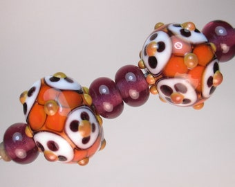 MATCHED PAIRS OF Handmade Lampwork Beads by Patti Cahill, War-o'-the-Dots Florals, + 4 coordinating Amethyst Plains (6 beads total)