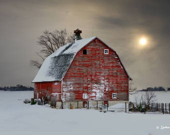 Red Barn in Winter # 36, Old Red barn in the snow at sunset.