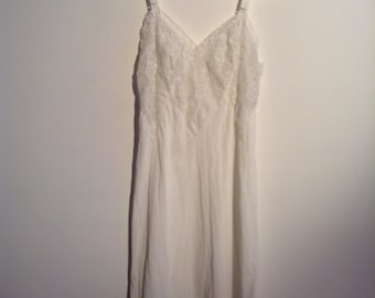 White  slip. All Nylon, chiffon and Lace.  Youth Form, size 32.  Vintage 1960