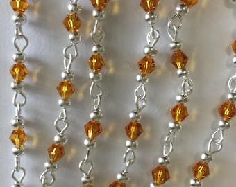 chain 55cm / 4mm Topaz glass bicone beads