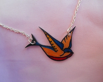 Necklace chain with swallow tattoo drawn plastic