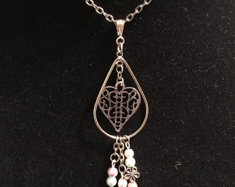Pastel pearls & flowers with heart pendant