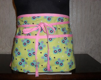 3 pocket waitress/utility half apron. Bright yellow/green background with butterflies.