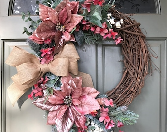 Holiday Christmas Wreath w/ pink poinsettias and greenery, frosted flowers, pine cones and metallic berries, burlap bow