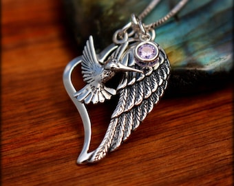Sterling silver hummingbird and angel wing necklace