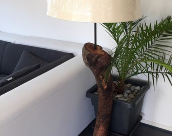 Floor lamp made of alluvial wood