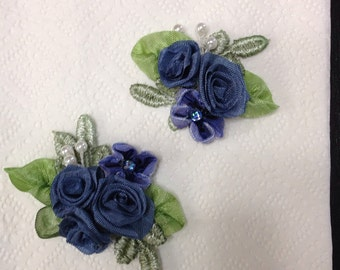 One hand made ribbon floral