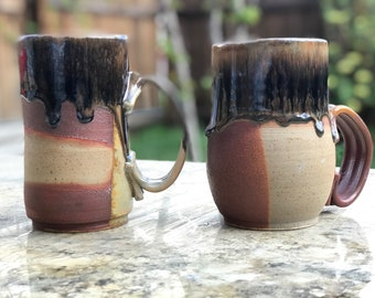 His and hers Pair of handmade stoneware mugs with black tar drip glaze