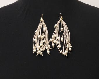 One of a Kind Earrings with Natural String Multi Strands and Ivory Bone Beads Knotted at Irregular Intervals. Matches Multi Strand Necklace.