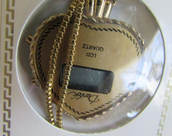 Pendant LCD Darhick Heart Pendant Watch New in box but don't know if it works.