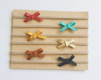 Genuine leather mini tiny baby bows in basic colors on nylon headbands or mini clips newborn infant toddler