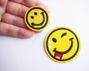 yellow happy face, emoji patch, smiley applique, winking tongue