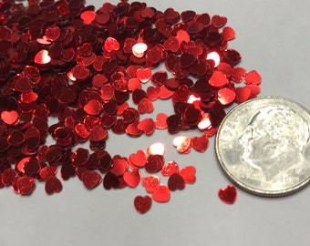 bag of Tiny red tinsel hearts, 3 mm (6)+