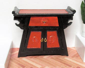Black and red Oriental style altar cabinet working drawer and doors. 1:12 scale dollhouse miniature. Handmade USA.