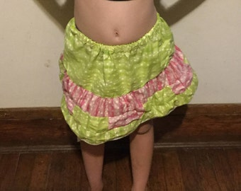 Young girl's pink and green skirt