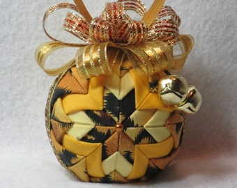 Christmas Ornament - quilted, no sew fabric ornament, tiger print folded fabric, fancy gold and bronze bow, with two gold jingle bells