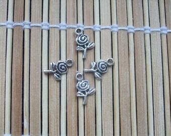 4 pink metal charms