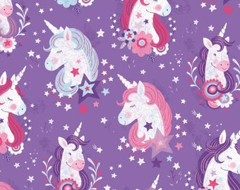Unicorn Heads on Purple From Studio E Fabric's Unicorn Kisses Collection by Lucie Crovatto