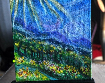 Artist Trading Card collectable of a whimsical landscape of a bright sunshine, blue sky ,forest comes with a black mini display easel
