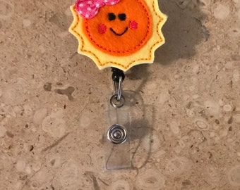 Felt sun retractable badge reel