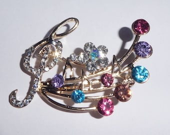 Brooch. Treble Clef and music score Rhinestones and coloured stones