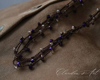 Crochet necklace with crystals black-gold-violet