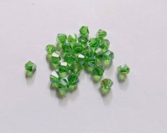 40 beads 4mm transparent green with reflections glass bicone
