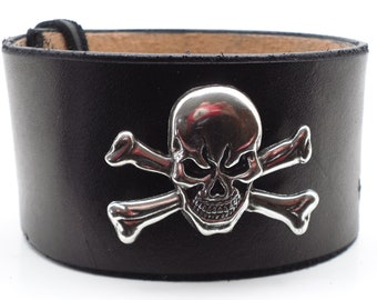 Traditional skull and crossed bones concho on black leather wristband