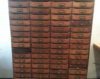 Vintage industrial 74 drawer cabinet.
