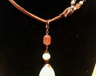 Handmade leather necklace with Jasper, Carnelian and Mother of Pearl with wire wrapped toggle and flower clasp.
