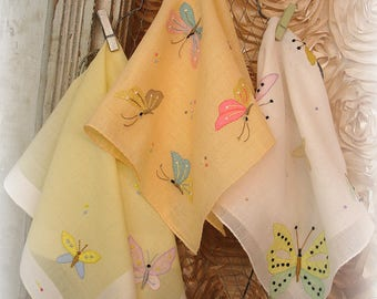 terrific trio 3 vintage butterfly hankies embroidery applique shades of yellow and peach pink blue green embroidered by hand hand embroidery