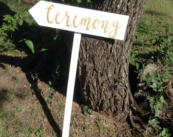 White Painted Rustic Wood Gold Wedding Ceremony Sign on Stake Arrow Country Modern Cursive Script