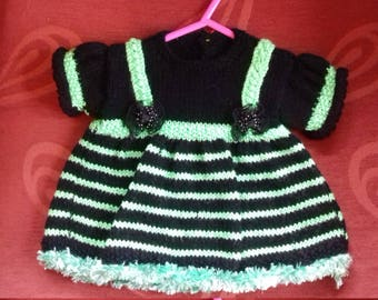Hand knitted dress to fit a newborn baby girl