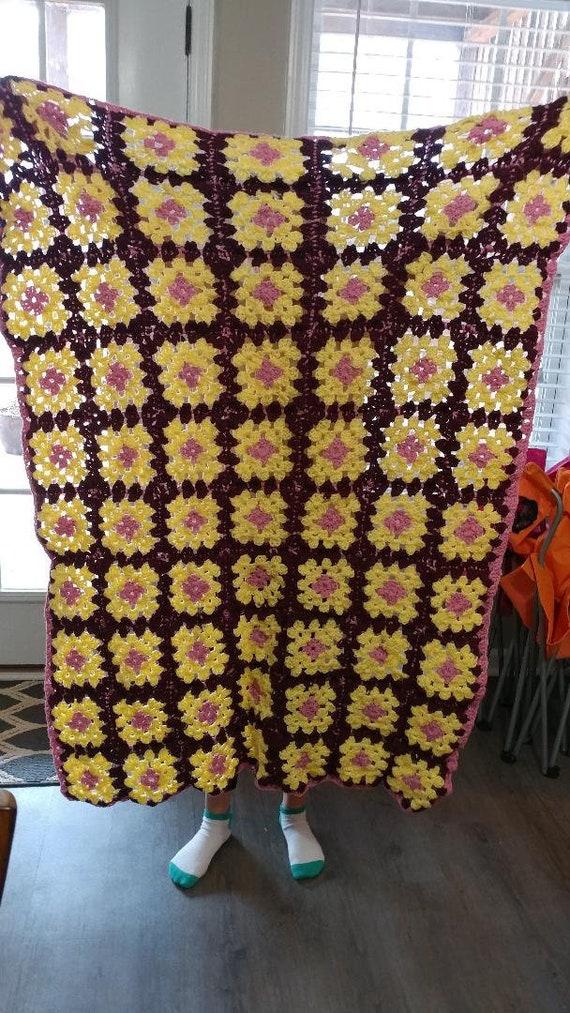 Burgundy & pink crocheted afgan