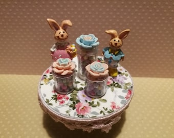 Dollhouse miniature trio of candy containers with flower on the lid