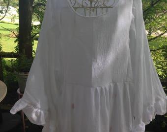 white ruffled blouse