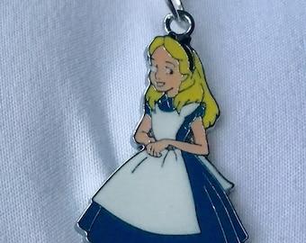 An enamel Alice in Wonderland necklace.