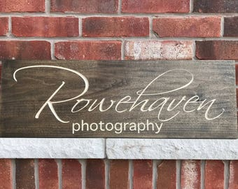 Dark stained wood Business Sign.
