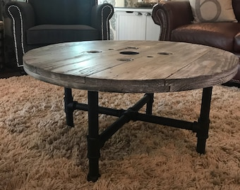 Reclaimed spool and iron pipe coffee table