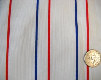 White cord pique fabric  with  red and blue stripe  3 yards