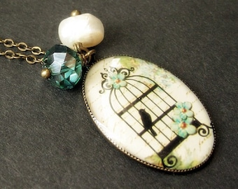 Birdcage Necklace in Cream with Teal Crystal Charm and Fresh Water Pearl. Handmade Jewelry.