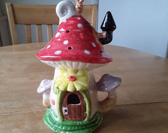 Fairy house. Hand painted tea light holder