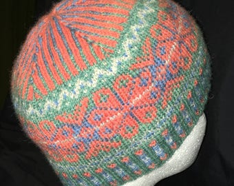 Keep out the cold this winter with a hand knitted Isle Inspired woolly hat. Made from Shetland yarn using natural dyes. Adult size.