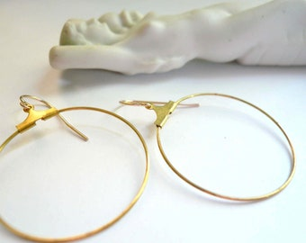Gold hoops. Vintage brass dangle hoops on new 14K gold fill ear wires.