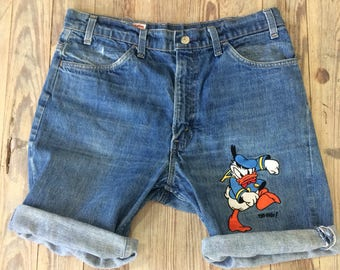 Too Cute/ Levis jean shorts with embroidered Donald Duck