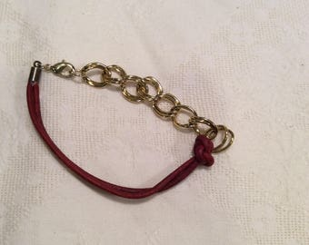crimson red cord and gold chain bracelet