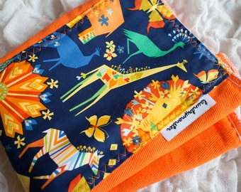 Baby burp cloth - safari on bright orange hand dyed burp cloth