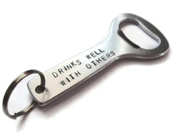 Custom Handstamped bottle opener keychain ..drinks well with others