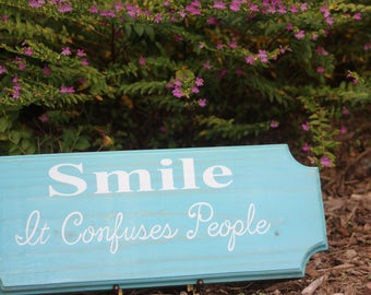 SMILE.......It confuses people wooden sign