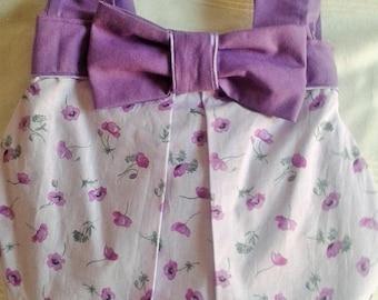 Wears mauve and purple flowers shoulder purse